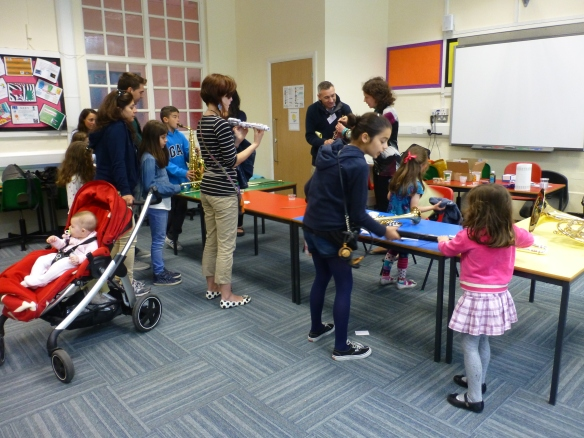Children (and parents) trying out instruments
